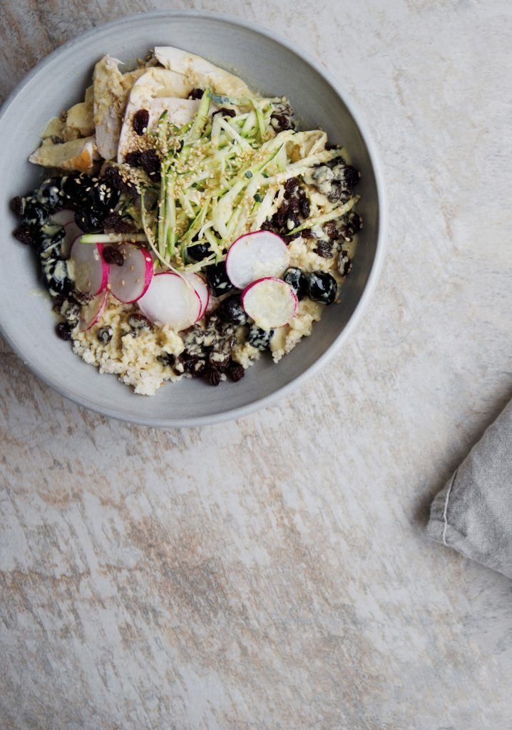 Millet, chicken, olives, grapes, radish bowl with a tahini sauce