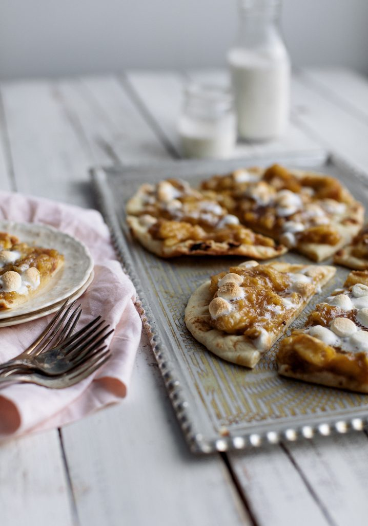 Oven baked naan bread topped with bananas, caramel & mini marshmallows